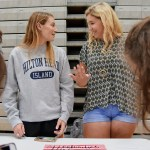 As students get in line to sign up for their SHARE project, seniors Loren Davis and Grace Garbe turn towards each other with excitement. Photo by Grace Goldman