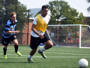 Senior Ian Schutt runs to try and catch up in hopes of getting possession of the ball. Photo by Katherine Odell