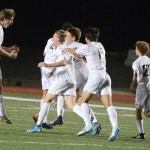 The varsity players celebrate after junior Connor O'Toole. Photo by Katherine McGinness