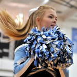 Sophomore Lena Madden performs with the varsity cheer squad while students arrive at the assembly. Photo by Maddie Smiley