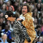 Sophomore Reilly Moreland rides sophomore Brigid Wentzs' back as they demonstrate what to wear for pajama day. Photo by Maddie Smiley