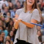 """Senior Allison Benson performs with her golf team. """"It was kinda confusing because Parker Gordon started to change the routine in the middle of the assembly. But it was really fun to participate."""" Photo by  Izzy Zanone"""