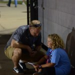 During the game, Assistant Principal Britt Haney kneels down to talk to his daughter. Photo by Reilly Moreland