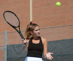 Sophomore Emme Tucker goes for slice while getting warmed up with her sister. Photo by Ty Browning