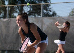 Sophomore Caroline Chisholm lines up as her partner returns the hit. Photo by Ty Browning