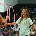 Sophomore Katie Aliber participates in the volleyball hula hoop activity. Photo by Ty Browning