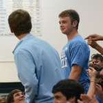 Selected to the cake-eating contest, sophomore JJ Ruf starts walking to the table. Photo by Ty Browning