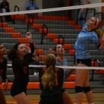 Sophomore Katie Aliber and Senior Sydney Ashner jump for the ball to hit it over the net. Photo by Aislinn Menke