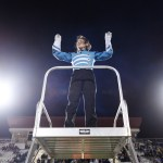 """Junior Nat Nitsch conducts the band playing songs from """"Harry Potter"""" during the halftime show. Photo by Diana Percy"""