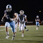 Senior Milton Braasch runs 37 yards for a touchdown with 7 minutes left in the 3rd quarter. Photo by Diana Percy