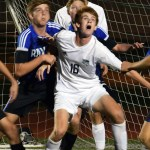 Junior Connor O'Toole fights for a header with defender. Photo by Audrey Kesler