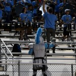 The Lancer Mascot dances along with the East band after a touchdown by East. Photo by Audrey Kesler