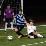 Senior Kristian Jespersen is fouled in the box by defender. Photo by Audrey Kesler