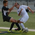 Senior Cooper McCullough attempts to get away from defender. Photo by Carson Holtgraves