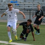 Senior Ian Schutt dribbles down the field past Park Hill South players. Photo by Carson Holtgraves