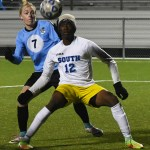 Senior Bennett Meeds attempts to get the ball away from the Olathe South player. Photo by Carson Holtgraves
