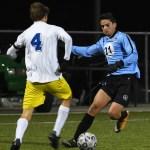 Junior Eren Eskinar dribbles toward the goal. Photo by Carson Holtgraves