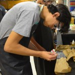 Sophomore Vincent Lee observes the results of the experiment. Photo by Kathleen Deedy