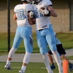 Junior Michael Perry celebrates his touchdown with teammate junior Pete Stanton. Photo by Katherine McGinness