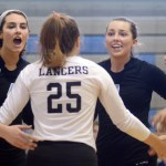 Sophomore Brigid Wentz and senior Sydney Ashner celebrate with their team after a successful play. Photo by Kate Nixon