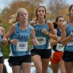 "Sophomore Kathleen Stanley, freshman Barbara DeZutter, sophomore Eleanor Hlobik, and junior Lucy Hoffman keep together while running. According to Hoffman, ""We focused on... staying in a pack... while running."" Photo by Luke Hoffman"