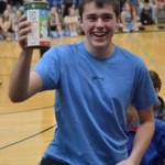 Junior Will Thomas holds a collection can to collect change in the junior section. Photo by Ally Griffith