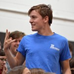 Sophomore Aidan Connelly waves to his friends after being chosen to participate in the can relay. Photo by Ally Griffith