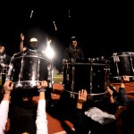 At the end of Drum Line's Kanye West inspired half time show, senior Oliver Nichols and junior Sid Choudhury fling their drumsticks behind them in excitement. Photo by Ellie Thoma