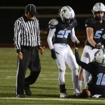 Juniors Dan Scott and Ryan Hess help their teammate junior Anderson Maddox get up after he gets tackled. Photo by Katherine McGinness