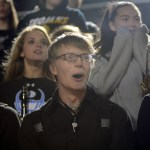 Junior drum major Becker Truster watches as the drum line performs their show. Photo by Kate Nixon
