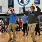 Sophomore Zach Ryland and junior Corbin Carroll try to beat each other during the can balancing contest. Photo by Lucy Morantz