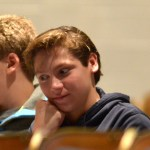 Freshmen Andrew Fey and Lawder DeSantis listen to the swim coach Wiley Wright during his presentation. Photo by Luke Hoffman