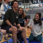 Seniors Kirby Motsinger and Julia Stopperan laugh as they shave senior Denny Rice's legs for the can drive assembly. Photo by Morgan Plunkett