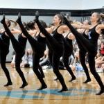 The varsity Lancer Dancers do a kick line while performing a 'Can-Can' dance. Photo by Maddie Smiley