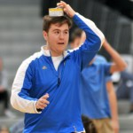 Senior Frank Schudy attempts to balance a can on his head during a relay. Photo by Maddie Smiley