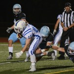 Sophomore Price Terill watches as his teammate brings down the ball carrier. Photo by Ty Browning