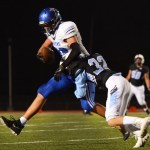 Michael Spivak tackles the defending ball carrier. Photo by Ava Simonsen