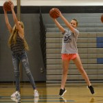 Lauren Sawalich, Brooke Birling, and Adria Foster dance with basketballs. Photo by Kathleen Deedy