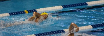 East Alumni Returns to Coach Girls' Swim