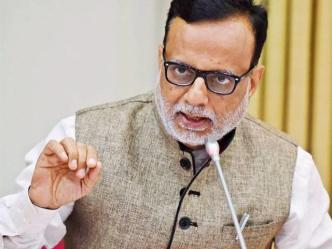 Hansmukh Adhia Revenue Secretary