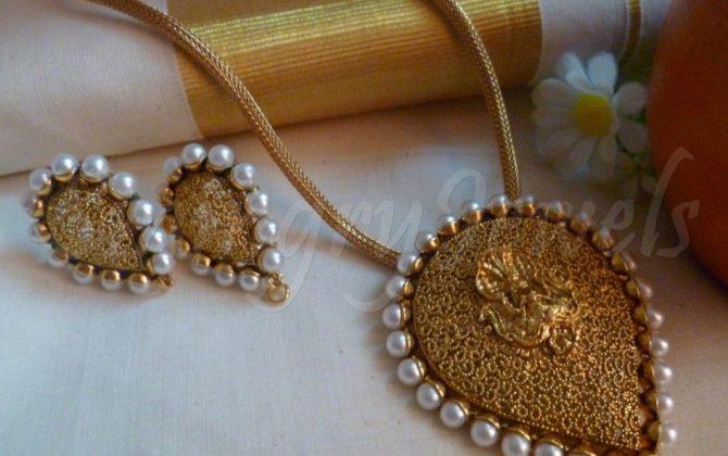 temple pendant oval shape and earrings ,Jewellery