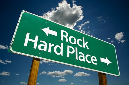 Rock and hard place road sign