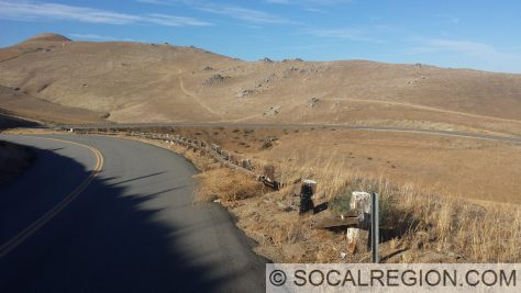 Former US 466 near Caliente in the Tehachapi Mountains. This is one of the longest remaining sections of original wooden railing in California.