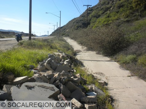 This is the last remaining uncovered stretch of the 1930 Newhall Alternate concrete. Motorcycle is on the 1951 alignment.