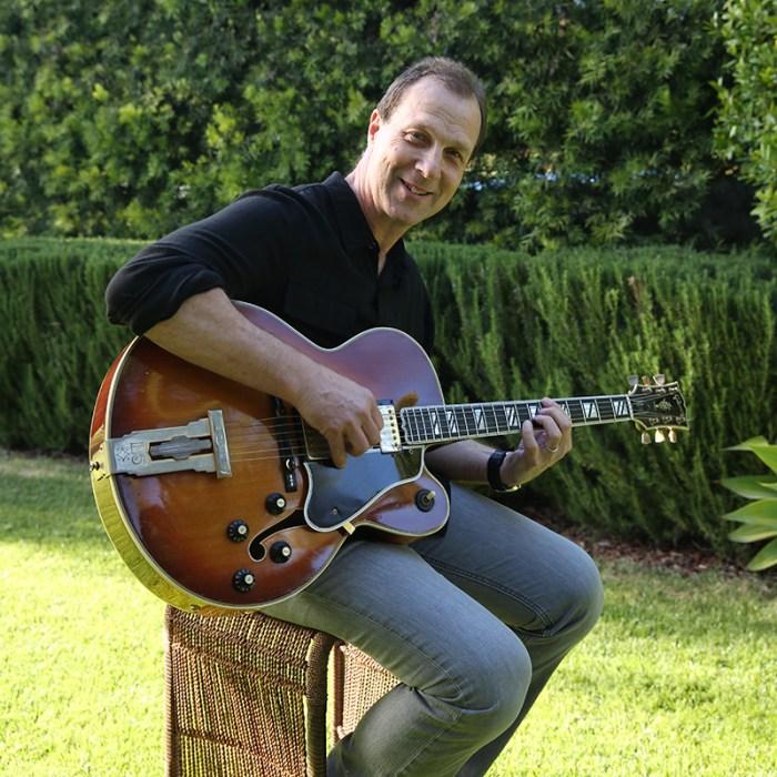 Baird-with-guitar-outdoors-800