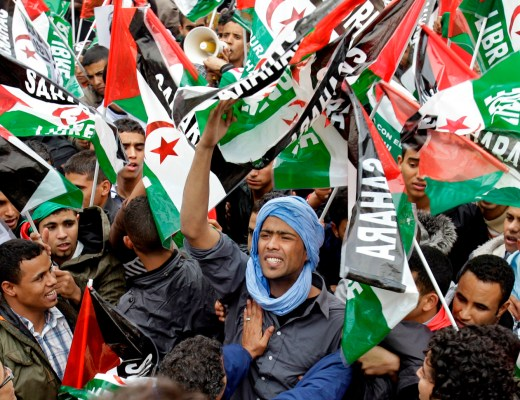 Protesters waving Western Sahara flags shout slogans during a protest against the Moroccan government, in Madrid, Saturday, Nov. 13, 2010.