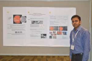 Touseef with academic poster