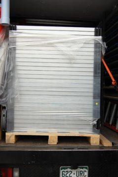 BEGINNING OF DAY 2, 9:10 a.m.: A palette full of 26 REC 215 Watt panels sits in the REC Solar truck ready to be unloaded.
