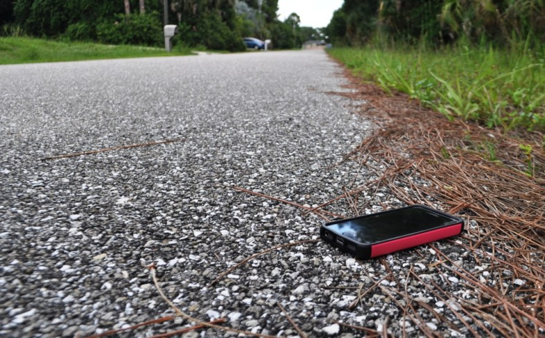 Oops! Dropped my iPhone 5 on the road during a walk. It was wearing its Urban Armor Gear case and looks and works fine.