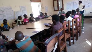 The National scream trainer facilitating a session during the training for Moroto peers